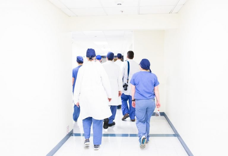 Outsourced neonatology team walking through hospital